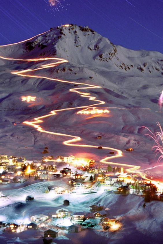 Arosa: this is an event in Switzerland where the mountain slopes are illuminated with fires to form large patterns for a night: