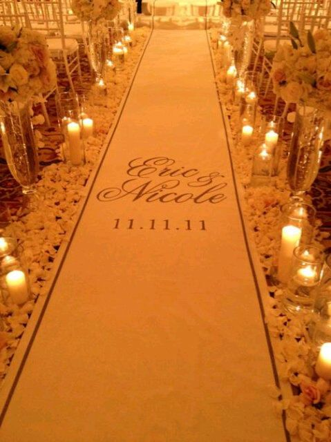 Monogrammed aisle runner by The Original Runner Co. Love the candles and the petals along the aisle!