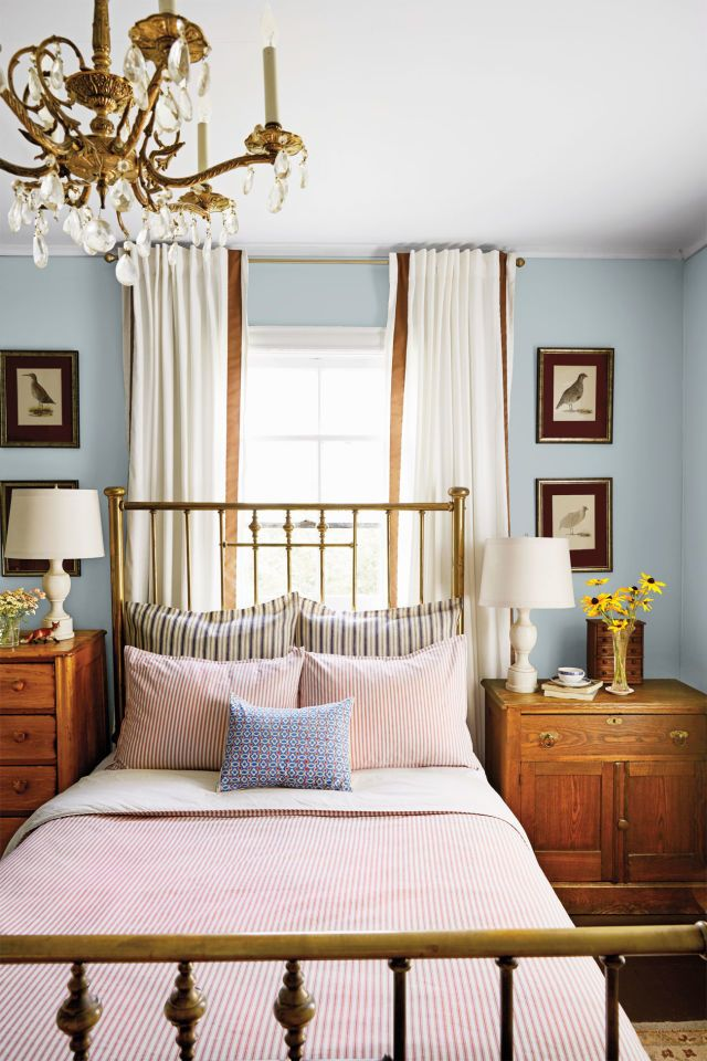 The home's red-and-blue palette takes a moodier turn in the master bedroom. An antique brass bed with a dramatic 54-inch-tall headboard adds to the sophisticated look.