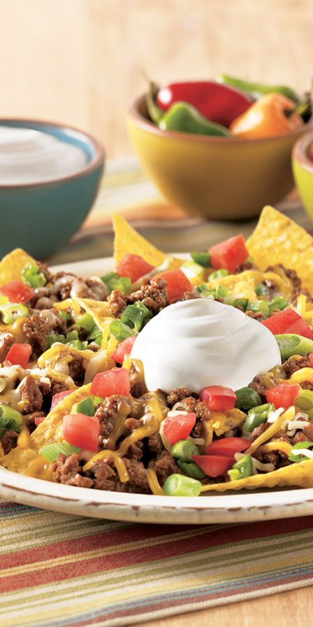 Make your Taco Tuesday feel like a Friday fiesta with these easy Loaded Beef Nachos! Loaded with tortilla chips, cheese, green onion and Daisy Sour Cream, this tasty dish is sure to be a crowd pleaser.