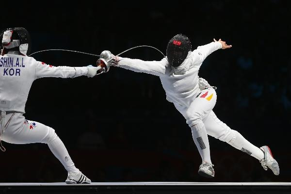: Britta Heidemann (R) of Germany battles against A Lam Shin of Korea (L) in the Women's Epee Individual Fencing Semifinals on Day 3 of the London 2012 Olympic Games at ExCeL on July 30, 2012 in London, England.