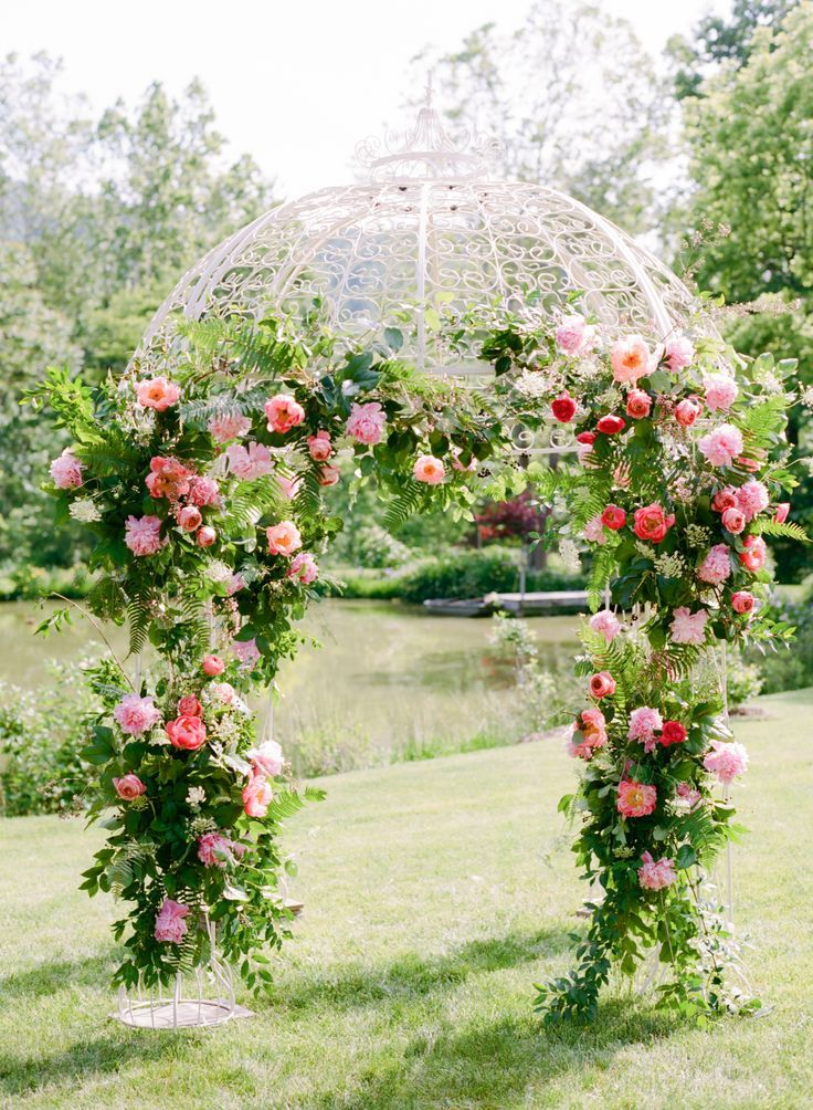 Beautiful garden arbor covered in roses