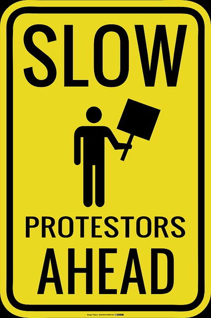 Slow, Protestors Ahead | Visit Occupy* Posters at http://owsposters.tumblr.com | You can wear most of these designs http://www.zazzle.com/occupyposters?rf=238102528680670219