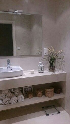 aplicacion de en paredes suelo y mueble encimera para bao