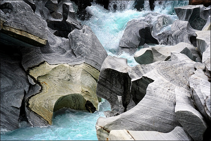 "Marmorslottet or ""marble palace"" near Mo i Rana in Norway. The river comes from a glacier."