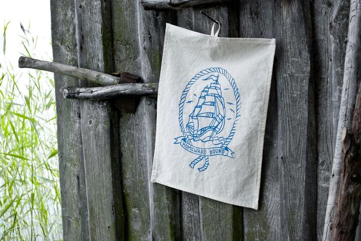 """Hand printed kitchen towel """"Homeward bound""""."""