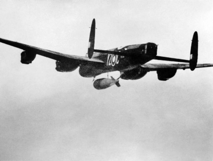 Pilot Officer P. Martin's Avro Lancaster B Mk.I Special, PB996, YZ-C, releases the 22,000-pound Grand Slam earth-penetrating bomb over teh railway viaduct at Arnsberg, Germany, 19 March 1945. (Imperial War Museum)