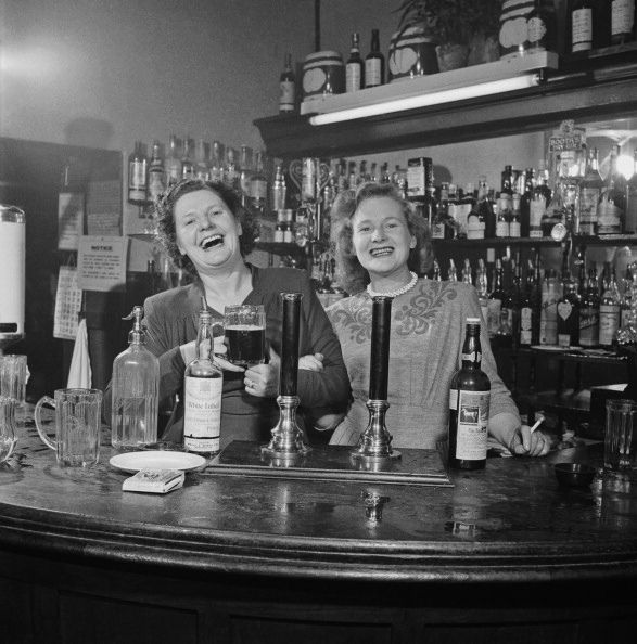 Two barmaids at a pub in London, c.1949.