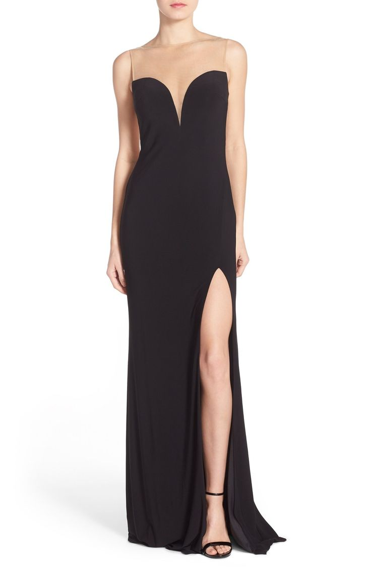 This chic black dress will turn heads with its high slit and dramatic sweetheart neckline.