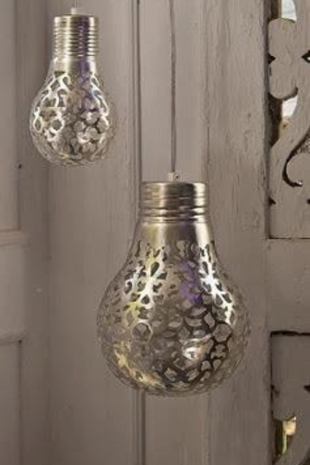 Hold lace over lightbulb and spray paint it. This is great for parties or weddings. Could make them any color!