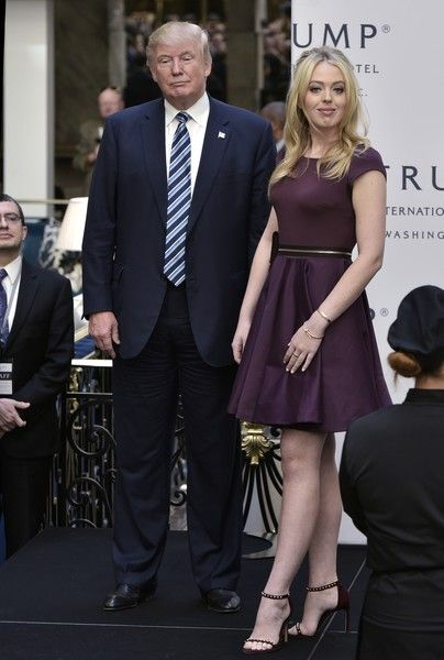 Republican presidential nominee Donald Trump (R) and Tiffany Trump take part in the ribbon cutting ceremony at the grand opening of the Trump International Hotel in Washington, DC on October 26, 2016. / AFP / MANDEL NGAN
