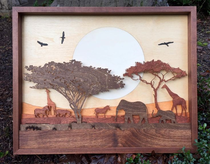 """We are so pleased to present our latest works.  We have created large scale scenes - this being our new African Wildlife 3D Shadow Box which has 7 wood layers and is intricately inlaid.  Measuring 25""""x20""""x1.5"""" this detailed scene brings the Serengeti into your home."""