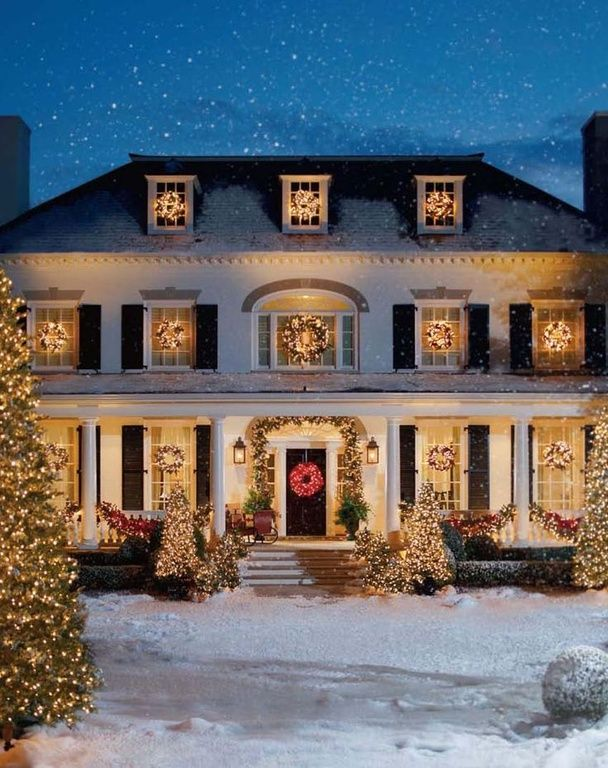 The first day of Christmas: A mansion with a snowy tree.