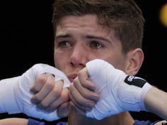 Luke Campbell of Great Britain, celebrates winning his fight against John Joe Nevin of Ireland, after their bantamweight 56-kg gold medal boxing match at the 2012 Summer Olympics, Saturday, Aug. 11, 2012, in London. (AP Photo/Ivan Sekretarev)