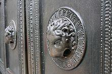 Lion head doorknocker of the Carolingian Wolf's door.