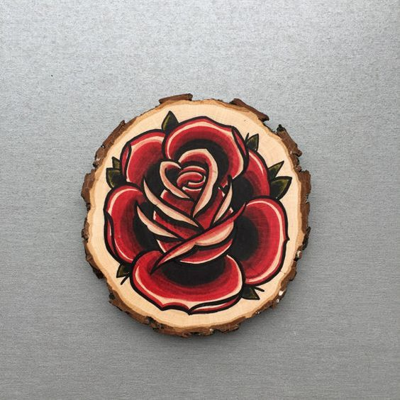 Wood slice with an original drawing of a rose 'tattoo style'