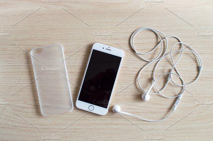 iPhone 6 with earphones - Mockup by Babi Guimarães on @creativemarket