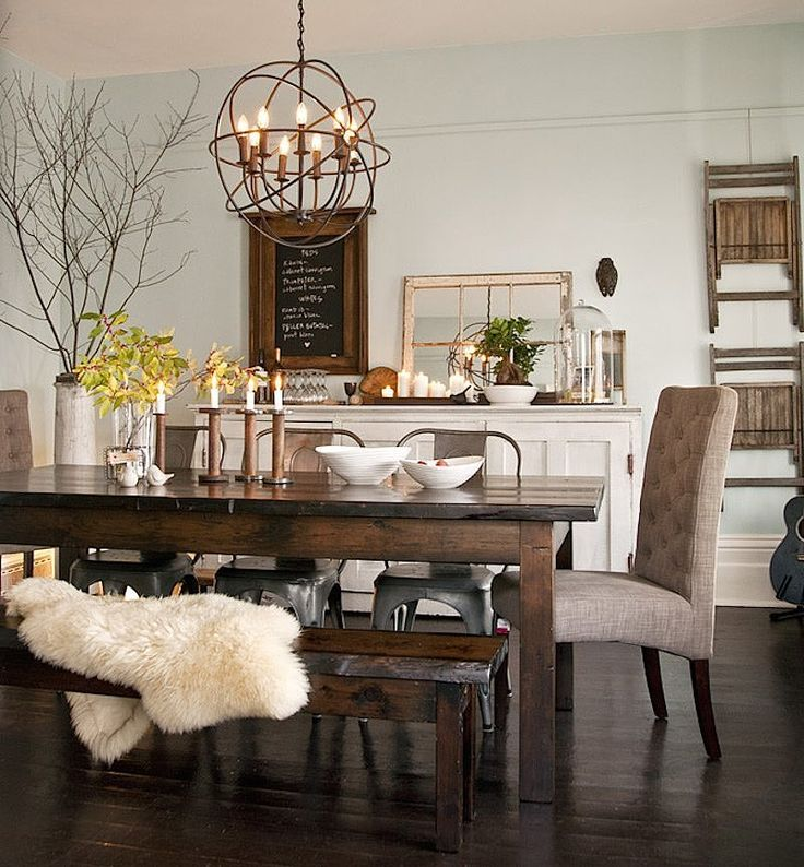 Dining room - Eclectic details like mismatched dining chairs and vintage-inspired accessories are paired with cozy accent...