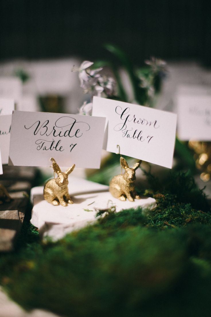 silver heart wedding place card holders%0A Small golden bunny rabbits as place card holders with flat escort cards  reading each guests u