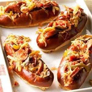 "Sausage and Kraut Buns Recipe -This recipe has become a regular at our church potlucks. Let's just say I'm ""in trouble"" if I show up at a get-together and they don't appear! For a fun dinner spin, try these sausages and kraut over mashed potatoes. —Patsy Unruh, Perryton, Texas"