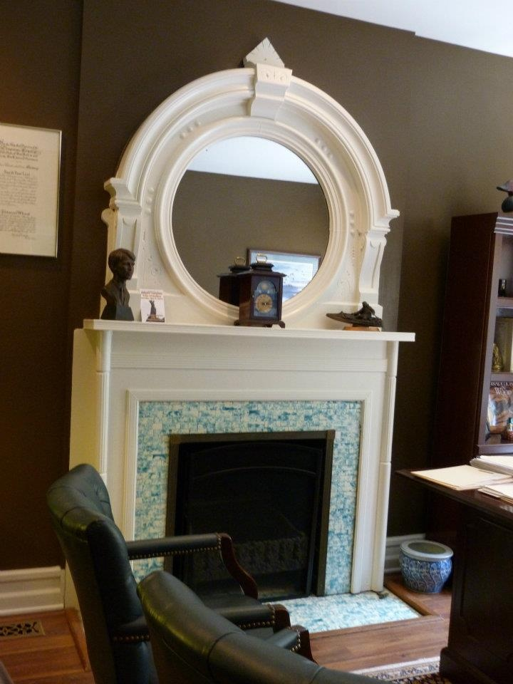 round, over mantel mirror  The round shape is a nice change.