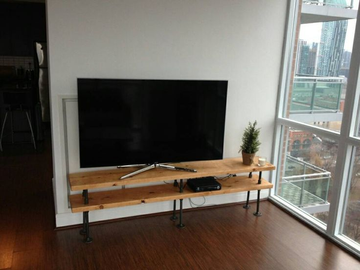 industrial pipe and wood tv stand by on etsy