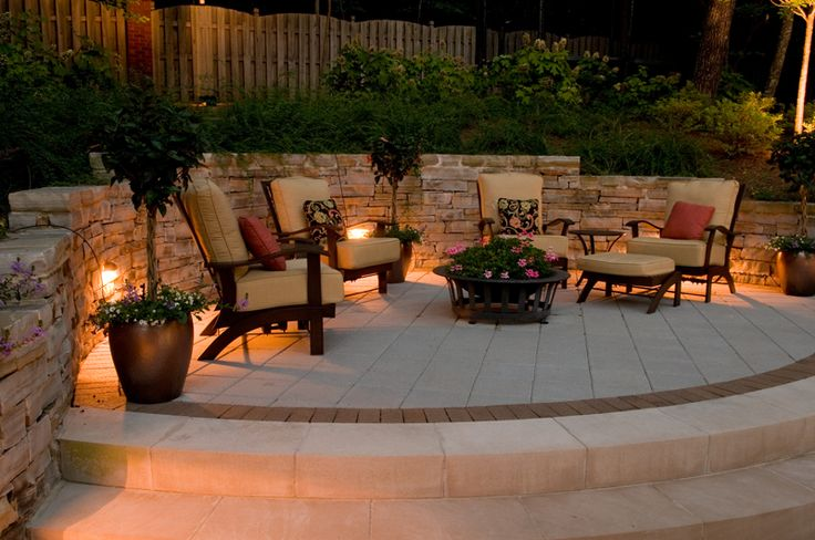 outdoor retaining wall with firepit and lighting   low voltage lighting on hardscaping are wall lights up down lights or ...