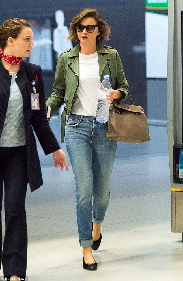 No signs of jet-lag! Model Miranda Kerr, 33, looked incredible in her green leather biker jacket and slim-fit jeans as she arrived at New York's JFK airport on Sunday
