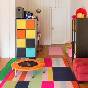 Bold colors are the way to go for a playful yet functional space. Use sectional furniture pieces to divide a room into study areas and more active spaces, to provide your little ones with all the latitude they need.
