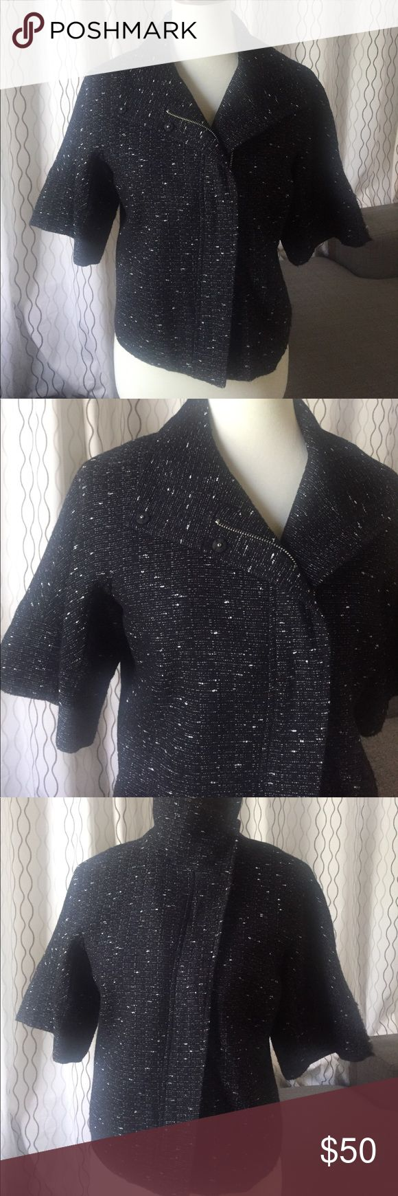 Kenneth Cole Short Sleeve Women's Tweed Jacket 6 This unique Kenneth Cole short sleeve jacket is a black and white speckled tweed(80% acrylic & 20% Polyester). The zipper and buttons allow for two different styles(see photos) when closed. The length is shorter, so the bottom will hit around the top of your hip bone. Pairs nicely with a white t-shirt and black boots. Size 6. Comes from a smoke free, pet free home. Kenneth Cole Jackets & Coats