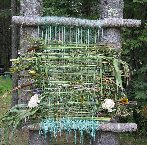 This would be fun to have set up and each person who wants weaves an item into the art work.