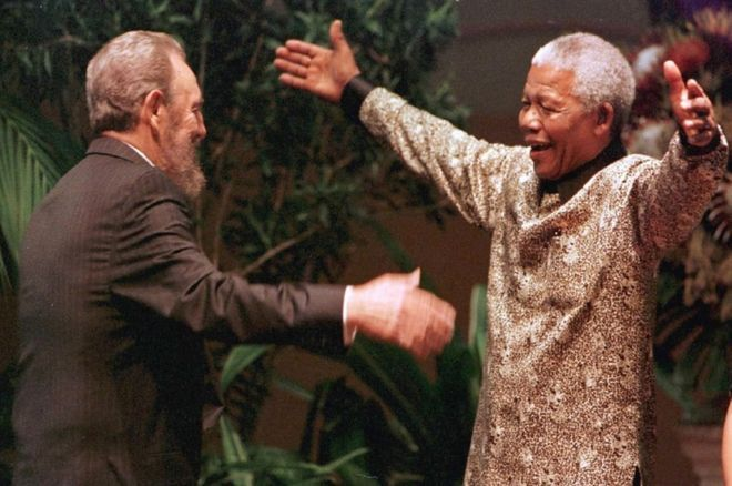 This photo taken on September 2, 1998 shows South African President Nelson Mandela greeting Cuban leader Fidel Castro as he arrives for the opening of the 12th Non-Aligned Movement summit in Durban, South Africa.