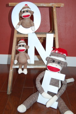 Cute sock monkey theme using 4x4 plywood, paint and baseboard trim.  Easy.