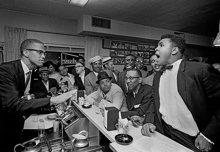 March 1964 - Miami: Malcolm X with  Muhammad Ali, after he beat Sonny Liston for the heavyweight championship of the world. ~ Bob Gomel