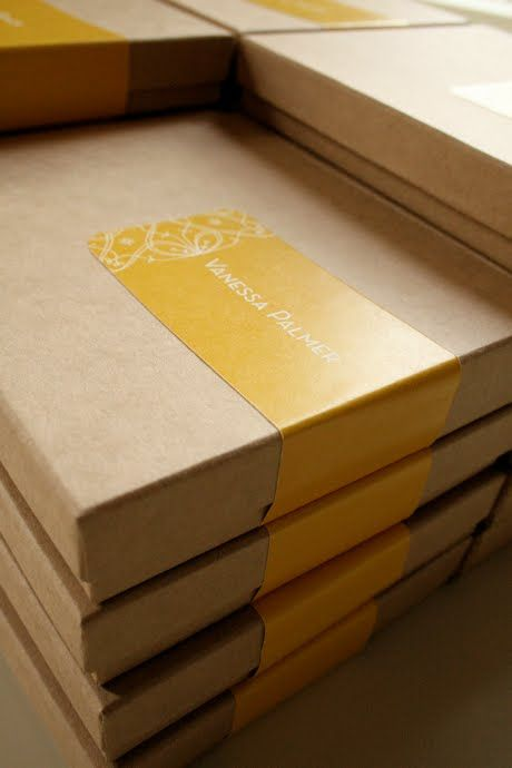 Simple packaging - kraft boxes with one label. You can choose another box color and use a die-cut label.