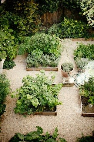 heirloom philosophy - a photo of a French kitchen garden. Love the layout of these raised beds, paired with pea gravel paths! Clean and classic.