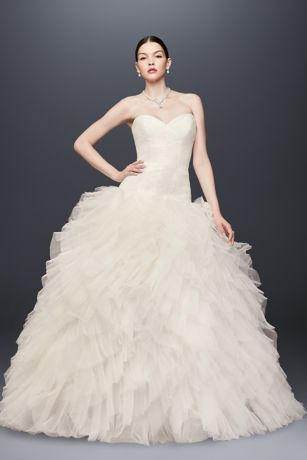 "The dramatic layered tulle skirt of this Truly Zac Posen plus size ball gown is sure to make your guests say, ""Wow."" Balanced by a slim, micro-pleated, drop-waist tulle bodice, this extravagant wedding dress is completely glamorous.   Truly Zac Posen, exclusively at David's Bridal  4"" extra length  Polyester  Sweep train  Back zipper; fully lined  Dry clean  Imported  Also available in regular and petite"
