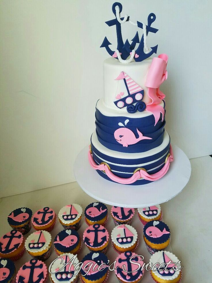Girl pink and blue nautical themed birthday cake and matching cupcakes