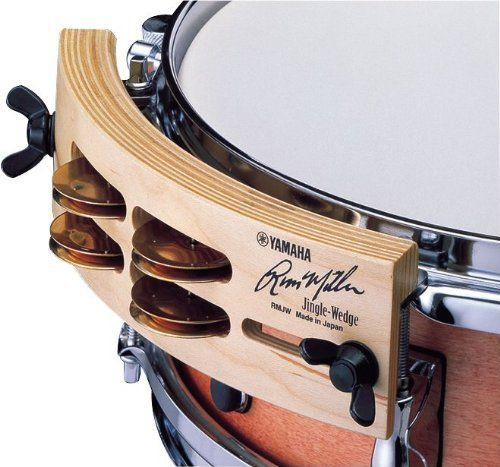 "Yamaha Russ Miller Signature Wedges RM-JW Percussion Blocks by Yamaha. $40.77. Jingle wedge, Russ Miller. The Russ Miller jingle wedge attaches to most 10"" to 15"" drums. The jingle wedge adds the nuance of a tambourine to the beat. It layers well with the sound of the other drums and is perfect for creating those R backbeats when layered with the snare drum.. Save 52%!"