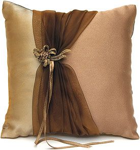 elegant throw pillow with ribbon-gathered scarf-like material wrapped around it