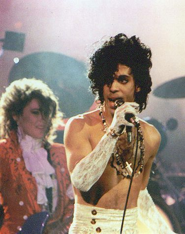 Picture of Prince & The Revolution. A muscly arm and a lacy glove. What's not to adore?