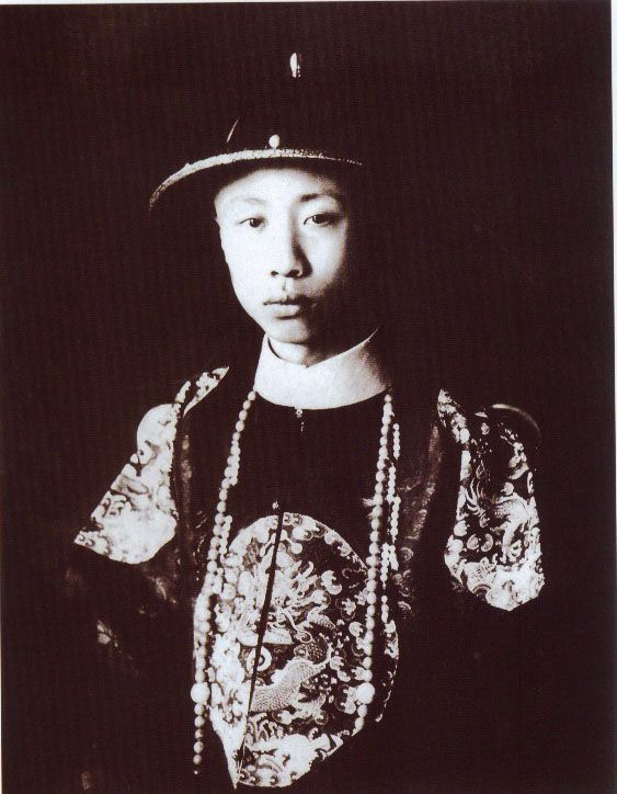 Qing Dynasty Emperor Henry Pu Yi, wearing Court attire, showing the front imperial roundrel insignia rank.
