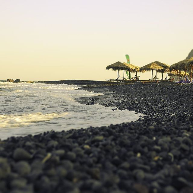 Artistic photo of Kamari #beach on #Santorini! Photo credits: @anna_sulte