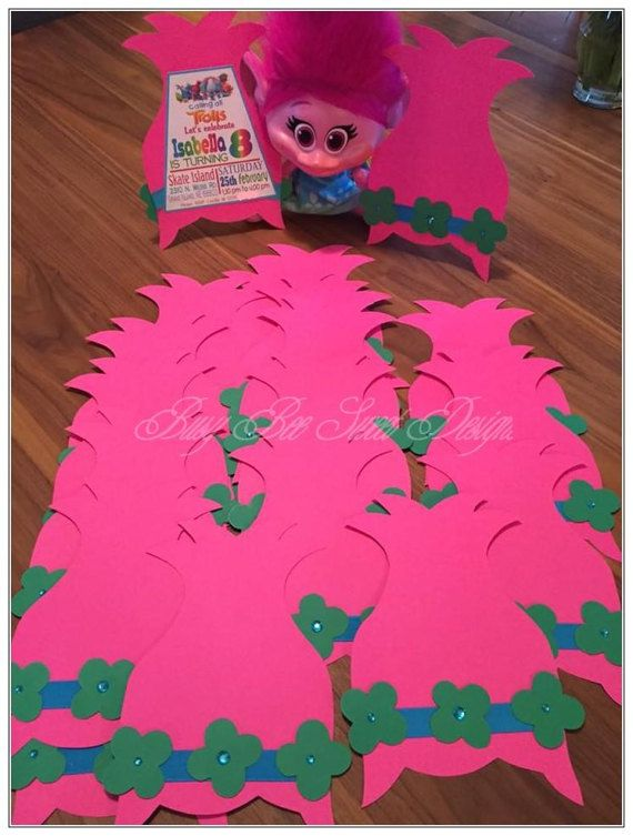 Cute Trolls Poppy Hair Invitation Card for that beautiful party!  Start an amazing party full of hugs and smiles by sending this cute Trolls Poppy Hair Theme invitation to family and friends.  This Trolls Poppy Hair Invitation invite to reveal the message of the party. This can be personalize with your own invite message. The invitation is made of hot pink card stock with green three flowers with gems in the center and a blue ribbon around the card. (As showing in the picture above)  Price…