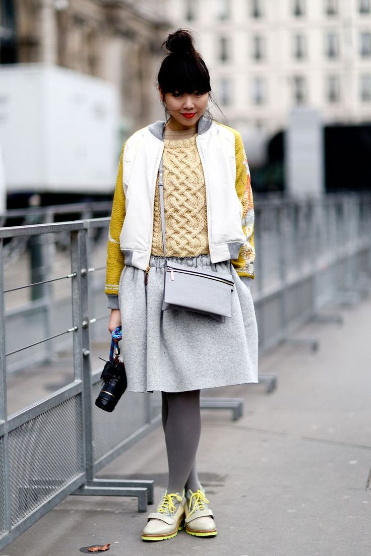 Perfect color match with pale yellow knit, sportswear jacket, grey wool skirt and acne boots via stylebubble
