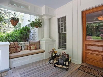 Have never seen a built-in seat like this on a porch - love.