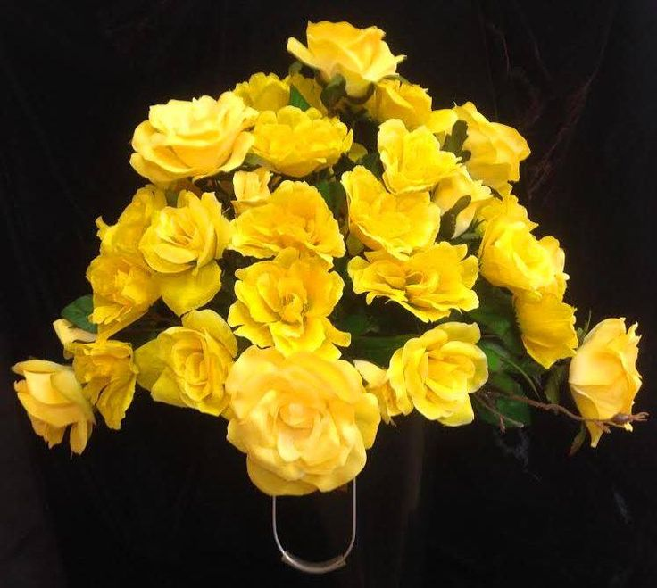 This holiday season, remember loved ones who are no longer with us. A cemetery arrangement from stems etc., in yellow roses -- a favourite of this clients' wife.