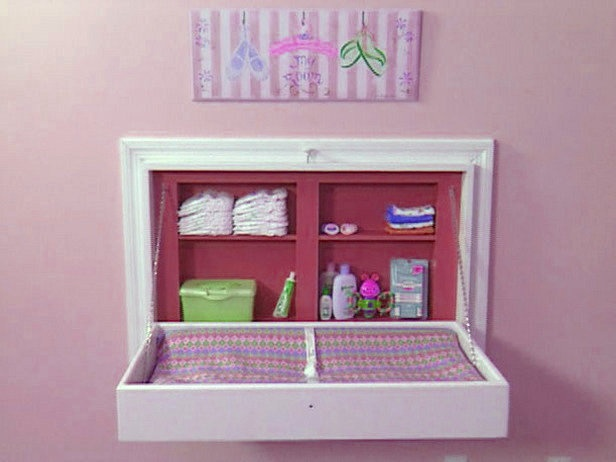 Foldable wall diaper changing station in the nursery. Organizes & saves room :)