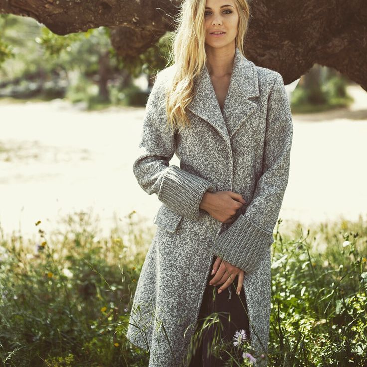 Winter coat with hand knitted cuffs
