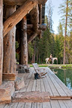 You know you have #porch envy when you can picture cowboy boots on your feet, lemonade in your hand, and  that rocking chair all day long...By Dan Joseph Architects Big Sky, Montana